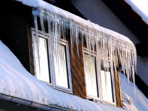 Ice hanging from house_insulation problem_RenoQuotes.com