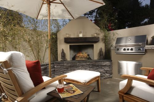 Backyard deck with fireplace_RenoQuotes.com