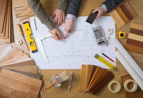 People working on house plan
