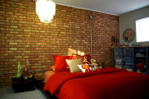 Exposed brick wall bedroom_RenoQuotes.com