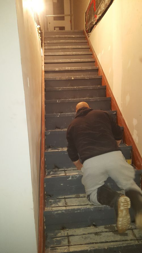 Man renovating staircase_RenoQuotes.com