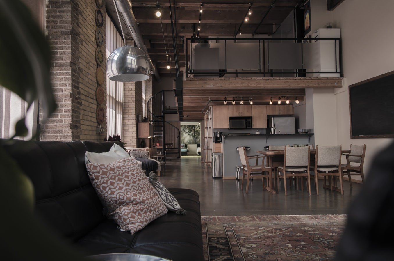 Industrial kitchen and dining room loft area